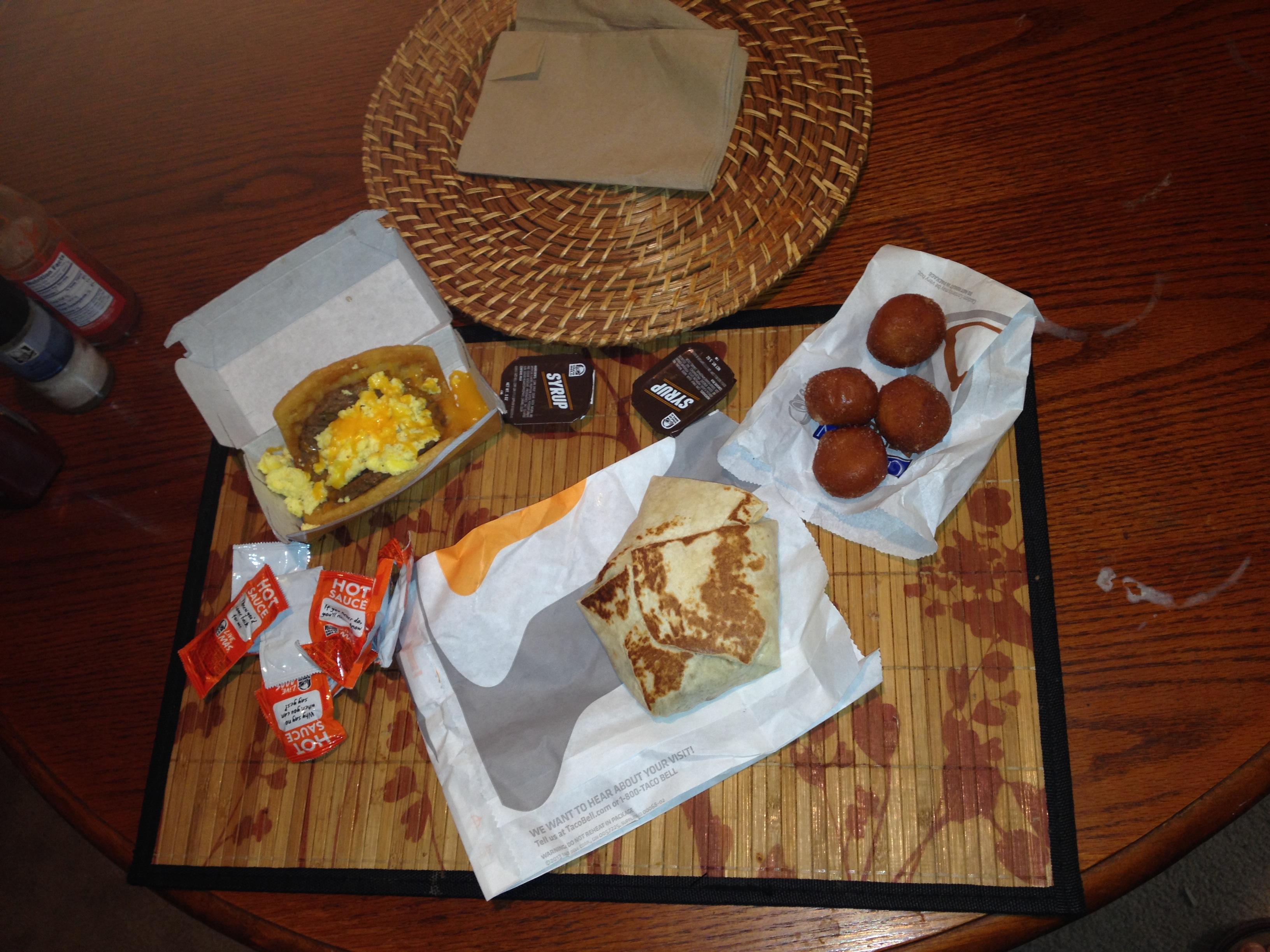 Clockwise from upper left: Waffle taco, Cinnabon Delights, A.M. Crunchwrap.
